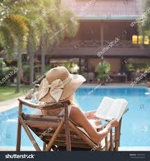 outdoor reading chair woman reading book deck chair near stock photo 131613413