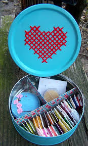 spotted cross stitch cookie tin and 10 other altered containers