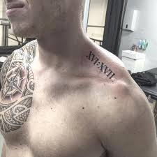 roman numeral tattoo on side neck by dizzy