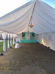 tent draping tent with draping chandelier and dessert table in backyard