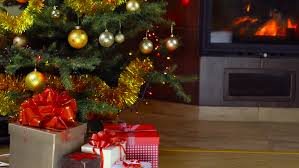 gift box and christmas tree on fireplace background stock footage