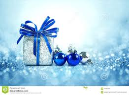 silver and blue balls and gifts on cool glitter lighti