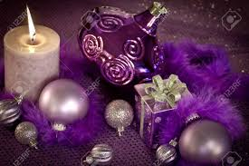 purple decorations with ornaments present and lighted