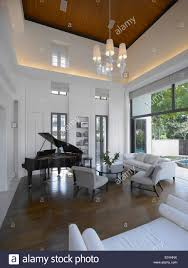 grand piano in living room of private residence singapore stock