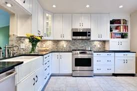polished granite countertops white kitchen black island backsplash
