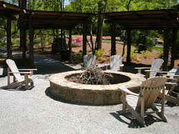 Pergola With Fire Pit by Traditional Style Stone Round Veneered Firepit On Grey Gravel