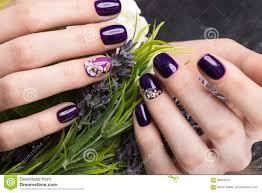 shot beautiful manicure with flowers on female fingers nails
