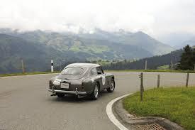 aston martin mountain landscape road vintage old car car