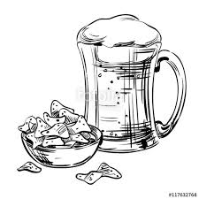 beer in a glass mug and fast food snacks nachos chips with spices