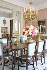 traditional pink dining room with candle chandelier luxe