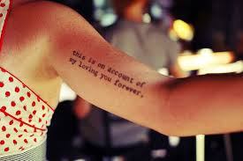 simple and black quote on arm tattoomagz