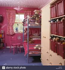 Plastic Bunk Beds Metal Bunk Beds In Child S Bright Pink Nineties Bedroom With
