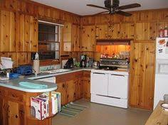 A Little Kitchen Lightens Up Kitchens Knotty Pine And Lights - Rustic pine kitchen cabinets