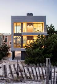 this modern beach house is a replacement for a home that was
