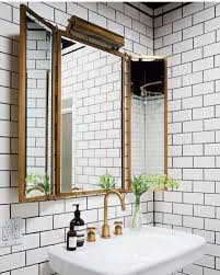what is subway tile floor to ceiling white subway tile black grout and brass fixtures