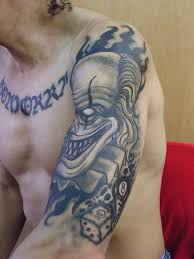 grey ink smiling evil clown on sleeve truetattoos