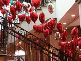 valentines day baloons heart shaped balloons cascading winding staircase to celebrate