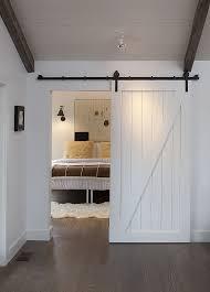 bedroom sliding doors 25 bedrooms that showcase the beauty of sliding barn doors