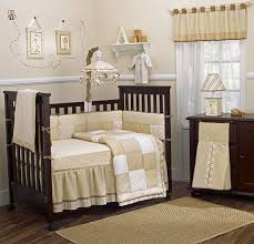 baby room wall theme with brown wooden baby crib and bedding