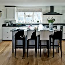 cabinet kitchens with black floors white kitchens ideal home