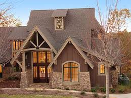 craftsman house plans with walkout basement timbering and expansive windows hint at what s in