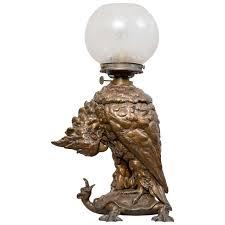 american victorian kerosene figural table lamp cockatoo on turtle