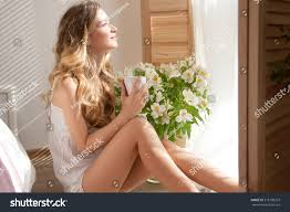 beautiful happy woman looking morning window stock photo 318190253 beautiful happy woman looking at the morning window out of the bedroom with a cup of