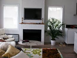 furniture bed room with white brick fireplace under wall mount tv