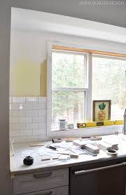 kitchen clear glass window design with subway tile backsplash and