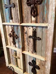 rustic crosses rustic crosses placed on salvaged antique window by justmeandmom