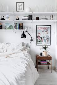 Small White Shelves by To Add Storage Space To A Small Bedroom Install Shelves Above The