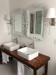 Bathroom Vanities With Sinks And Tops by White Bathroom With Vessel Sinks And Wood Table As Vanity Like The