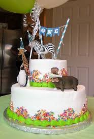 first birthday cake party animal theme with plastic schleich