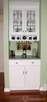 built in wine bar cabinets painted white dayton kitchen cabinets from cliqstudios with a built