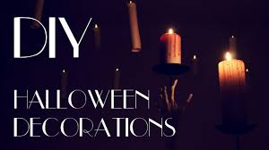 diy creepy halloween decorations corpse hand bloody candles