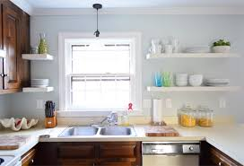 hanging ikea floating shelves in our kitchen young house love