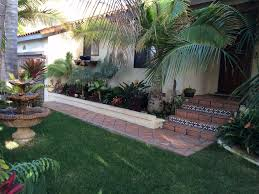Outdoor Areas by Spanish Style Beach House With Tropical Lan Vrbo