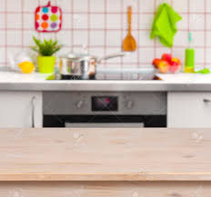 wooden table on blurred kitchen bench background stock photo