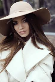 straight hair with outfits glamour girl with dark straight hair wears luxurious beige coat