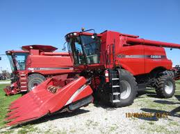 caseih 6130 axial flow with 6 row 3406 corn head next to older