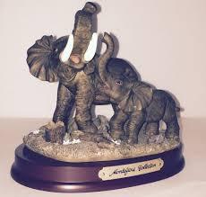 mom u0026 baby elephant figurines on wooden stand montefiori