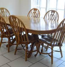 richardson brothers oak dining table and chairs ebth