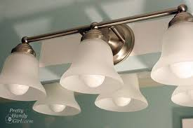 bathroom lighting how to change a bathroom light fixture how to