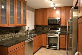 brown kitchen cabinets with backsplash creating a timeless kitchen in a st louis park cape cod
