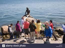 copenhagen denmark eu tourists photographing bronze little mermaid