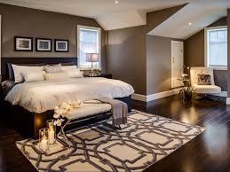 contemporary master bedroom with hardwood floors u0026 specialty door