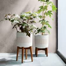 mid century turned leg standing planters solid west elm
