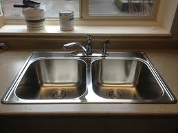 how to install a kitchen sink in a new countertop bathroom drain cleaning victoria blocked kitchen drains sewer