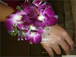 purple corsage wrist corsage with purple orchids and purple ribbon