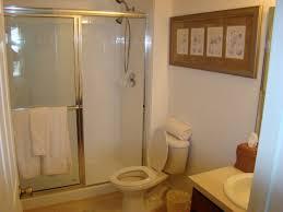 white toilet bowl with glazed shower areas having chrome towel